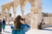 woman-taking-pictures-of-ruins-2087391.j