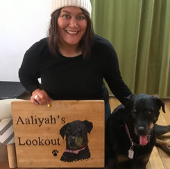 Happy client with her personalised wood painted sign