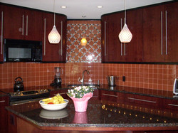 Picasa - Contemporary kitchen renovation with glass tile backsplash and granite
