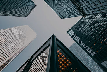 skyscrapers-looking-up_925x.darker.jpg
