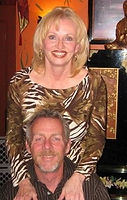 A Picture of Richard ans Kathe Szymanski smiling.