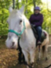 client riding horse