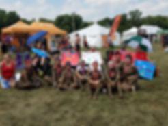 Clients & Staff at Warrior dash. Sitting on grass
