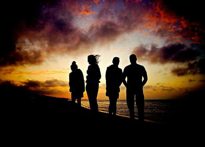 sunset-beach-silhouettes-against-the-lig