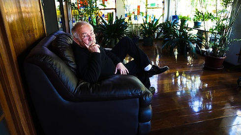 Henryk Szydlowski sitting on the couch colour photo