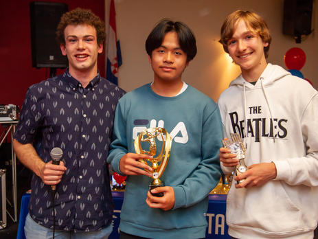 Ben Johnson (Coach of 9/10 Boys 'Red') with MVP Xander Intervencion and Coaches Award winner Ollie Parker