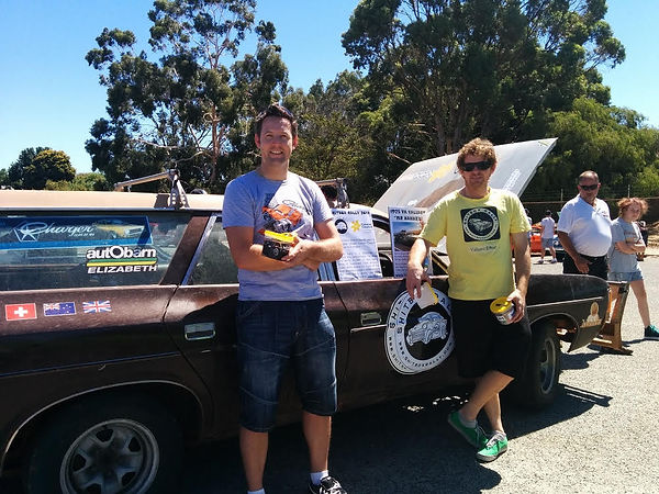 Layne of Perth Computer Help and friend Bruce, of Blue Star Garage, with their Shitbox Rally Car