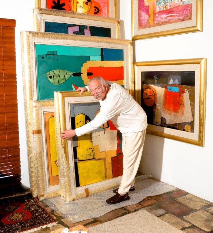 Henryk Szydlowski with artworks colour photo