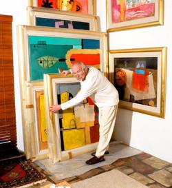 Henryk Szydlowski with artworks colour photo