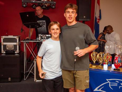 9/10 Boys Blue Coaches Award winner Kade Walker with Coach Ben Farley
