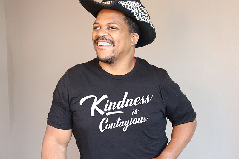 Yamada models a Kindness is Contagious T-shirts