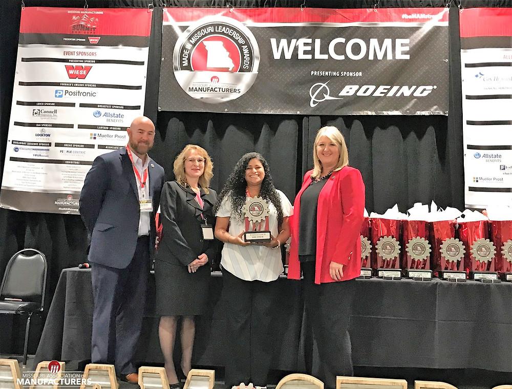 Jaclyn Norono-Rodriguez accepts BCI's MMLA award