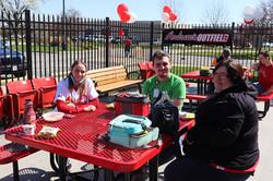 Employees enjoying lunch outside