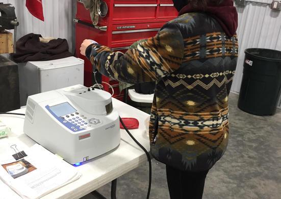 Josie running water samples through the spectrophotometer