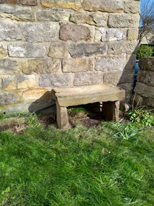 Stones from church hall steps make a good bench