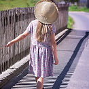 young girl walking away after scholiosis treatment