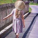young girl walking away