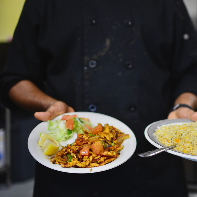 Shariif displays freshly prepared dishes