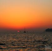 Sun Sinking Santorini