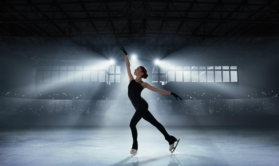 Figure skating girl in ice arena..jpg