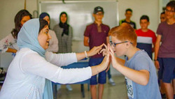 Teacher Loubna and her students in Drama class.