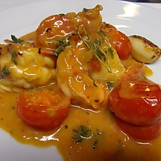 King Prawns with lemon sauce, chilli, cherry tomato and brandy.