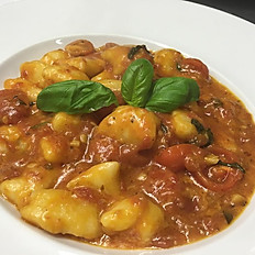 Homemade Gnocchi with tomato and basil