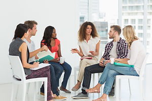 Therapist speaking to a rehab group at therapy session.jpg
