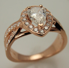rose gold pear shaped halo ring