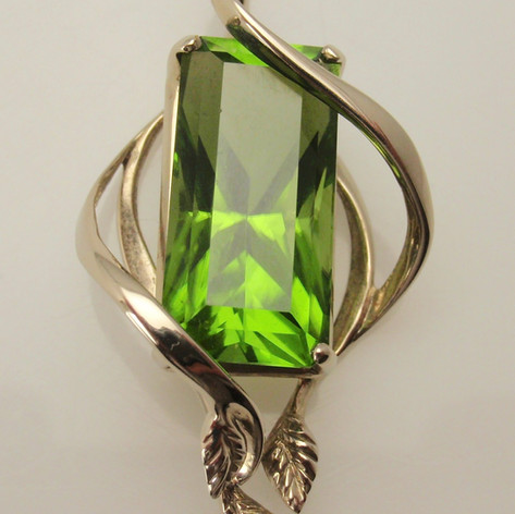 peridot in organic vine and leaf mounting