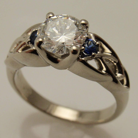 14kw diamond ring w/ sapphire accents and celtic trinity knot