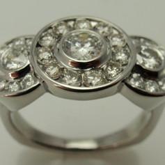 three stone ring w/ halos around each