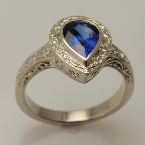 engraved halo pear shaped sapphire