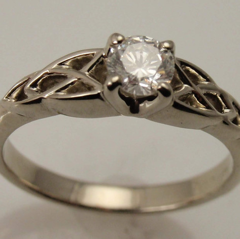 trinity knot solitaire ring