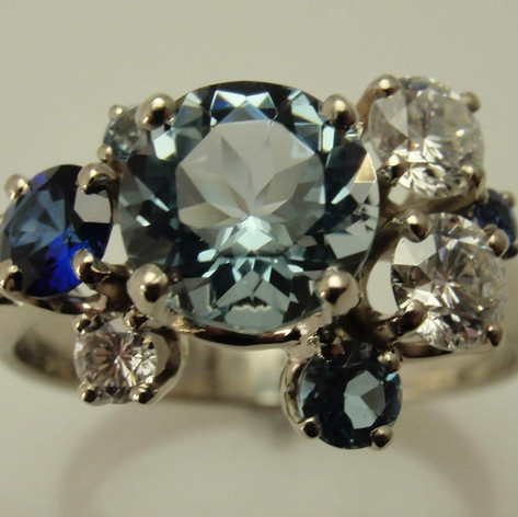 colored diamonds, diamonds and sapphires in cluster mounted ring