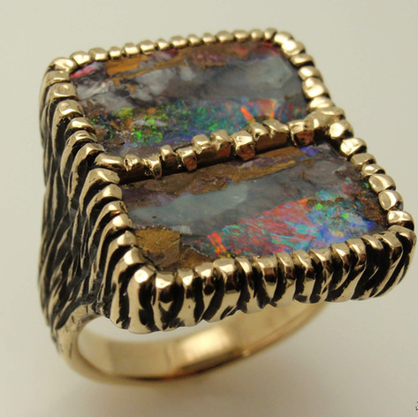 boulder opals in rustic mounting