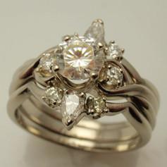 three ring set w/ round and pear shaped diamonds