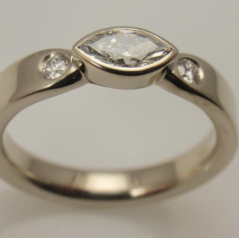 horizontally set marquise diamond three stone ring
