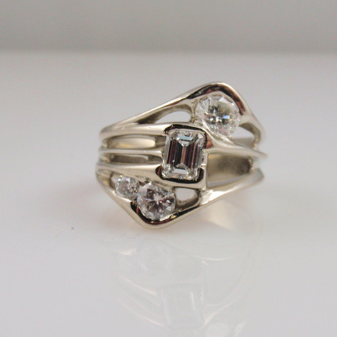 a modern mounting w/ heirloom diamonds