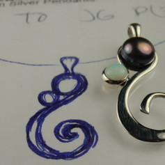 pearl and opal pendant w/ sketch in background