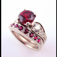 ruby center w/ diamond accents and a ruby wedding band
