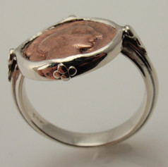 coin in silver ring