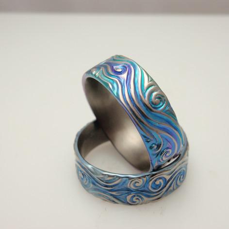 flowing swirling titanium rings