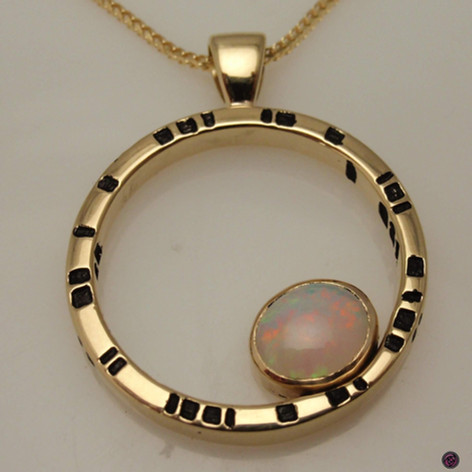 opal offset in circle pendant