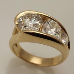 14ky gold three stone channel set diamond ring