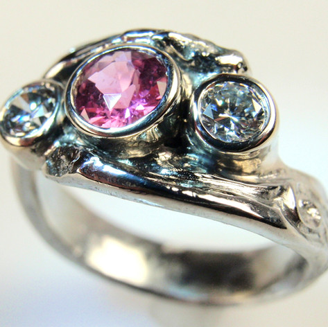 pink center bezel set ring