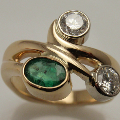 emerald and diamond modern 3 stone ring