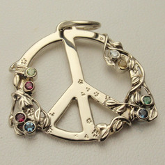 vines growing around a classic peace pendant