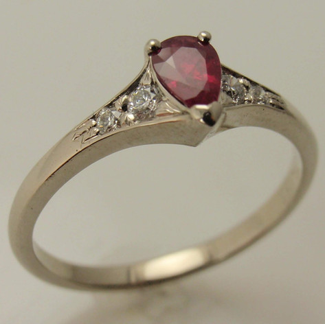 14kw gold pear shaped ruby ring flairs w/ bead set diamond accents