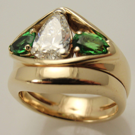 yellow gold wedding set with pear shaped center diamond and colored stone accents